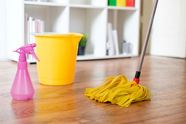 cleaning a floor by a wet mop by cleaning services in Mount Prospect