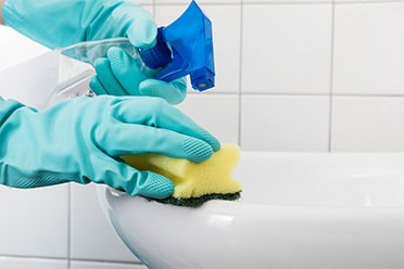 cleaning a bathroom by house cleaning services in Mount Prospect